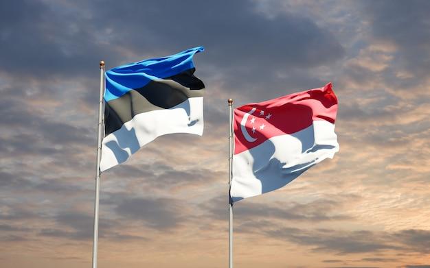 Beaux drapeaux des états nationaux de singapour et de l'estonie ensemble