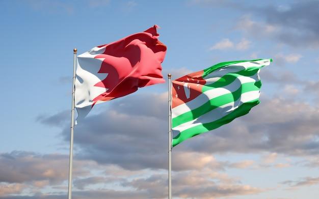 Beaux drapeaux nationaux de l'abkhazie et de bahreïn ensemble