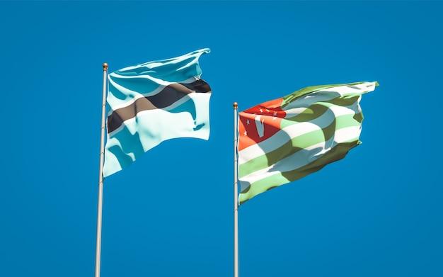 Beaux drapeaux nationaux de l'abkhazie et du botswana ensemble