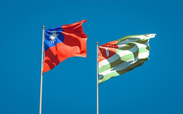 Beaux drapeaux nationaux de l'abkhazie et de taiwan ensemble