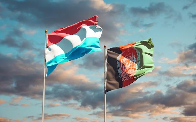 Beaux drapeaux nationaux de l'afghanistan et du luxembourg