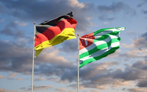 Beaux drapeaux nationaux de l'allemagne et de l'abkhazie ensemble