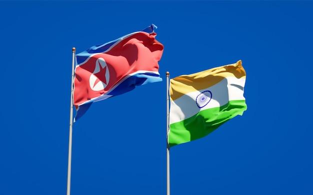Beaux drapeaux nationaux de la corée du nord et de l'inde ensemble