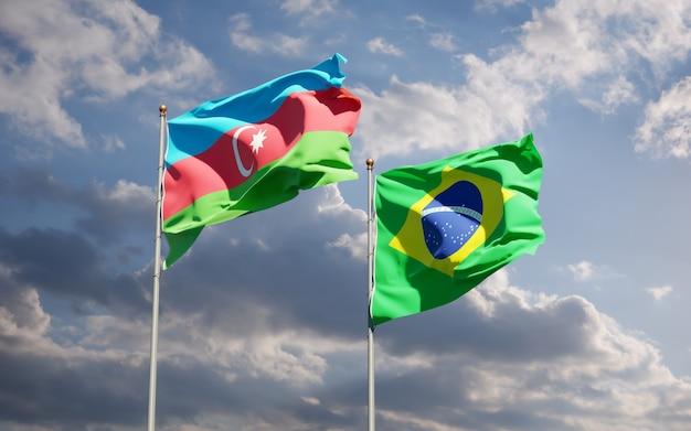 Beaux drapeaux nationaux du brésil et de l'azerbaïdjan ensemble sur ciel bleu