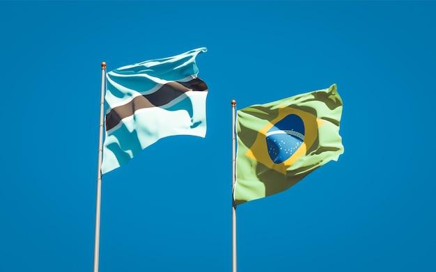 Beaux drapeaux nationaux du brésil et du botswana ensemble sur ciel bleu