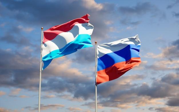 Beaux drapeaux nationaux du luxembourg et de la russie ensemble sur le ciel bleu. illustration 3d