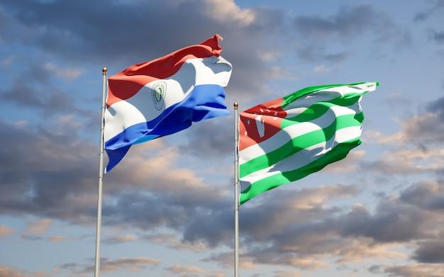 Beaux drapeaux nationaux du paraguay et de l'abkhazie ensemble