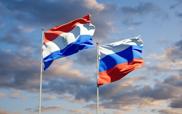 Beaux drapeaux nationaux du paraguay et de la russie ensemble sur le ciel bleu. illustration 3d