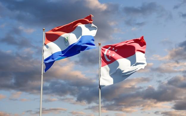 Beaux drapeaux nationaux du paraguay et de singapour ensemble