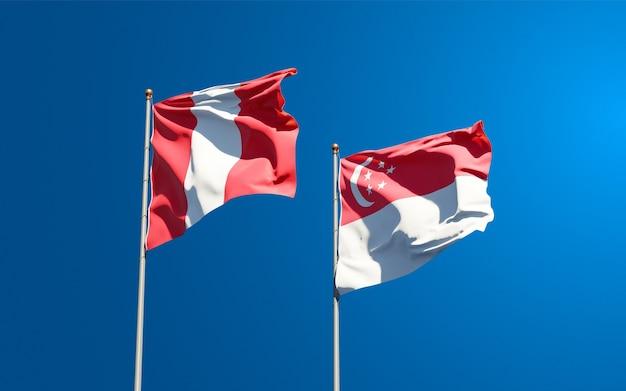Beaux drapeaux nationaux du pérou et de singapour ensemble