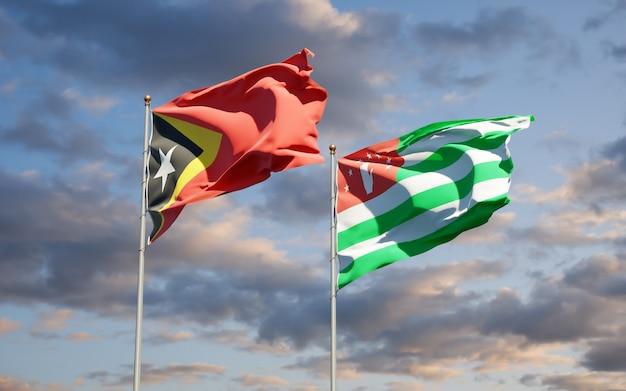 Beaux drapeaux nationaux du timor oriental et de l'abkhazie ensemble