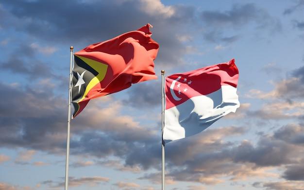 Beaux drapeaux nationaux du timor oriental et de singapour ensemble