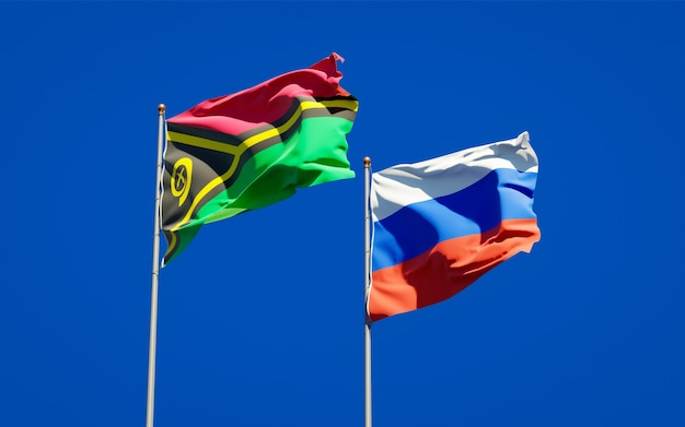 Beaux drapeaux nationaux du vanuatu et de la russie ensemble sur le ciel bleu. illustration 3d