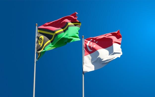 Beaux drapeaux nationaux du vanuatu et de singapour ensemble