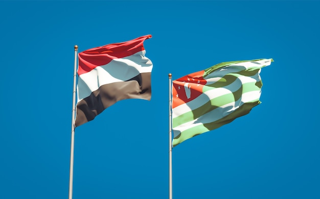 Beaux drapeaux nationaux du yémen et de l'abkhazie ensemble