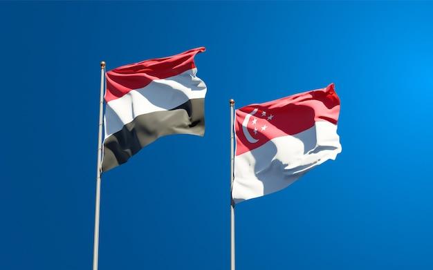 Beaux drapeaux nationaux du yémen et de singapour ensemble