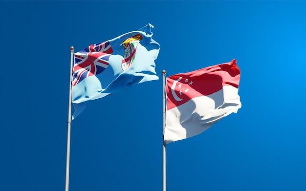 Beaux drapeaux nationaux des fidji et de singapour ensemble