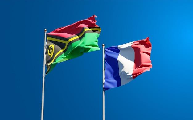 Beaux drapeaux nationaux de la france et du vanuatu ensemble au ciel