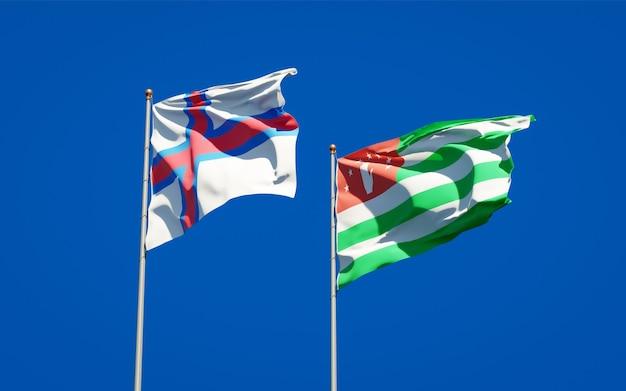 Beaux drapeaux nationaux des îles féroé et de l'abkhazie ensemble