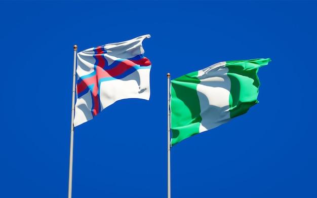 Beaux drapeaux nationaux des îles féroé et du nigéria ensemble sur ciel bleu