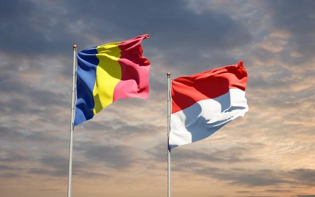 Beaux drapeaux nationaux de l'indonésie et du tchad ensemble sur ciel bleu