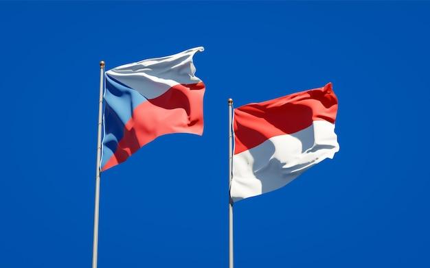 Beaux drapeaux nationaux de l'indonésie et du tchèque ensemble sur le ciel bleu