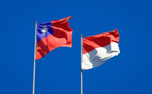 Beaux drapeaux nationaux de l'indonésie et de taiwan ensemble sur ciel bleu