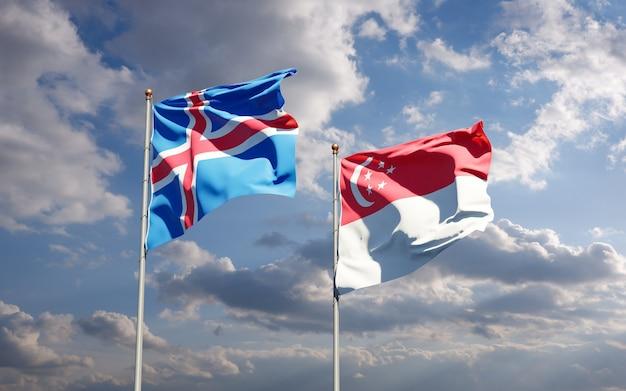 Beaux drapeaux nationaux de l'islande et de singapour ensemble