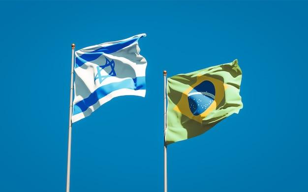 Beaux drapeaux nationaux d'israël et du brésil ensemble sur ciel bleu