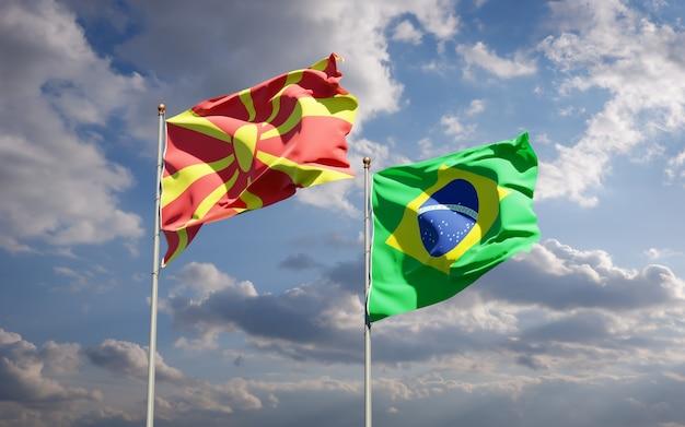Beaux drapeaux nationaux de la macédoine du nord et du brésil ensemble sur ciel bleu