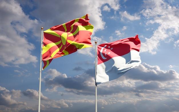 Beaux drapeaux nationaux de la macédoine du nord et de singapour ensemble