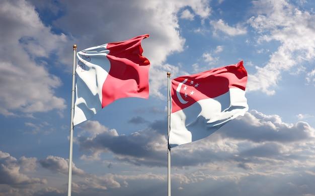 Beaux drapeaux nationaux de malte et de singapour ensemble
