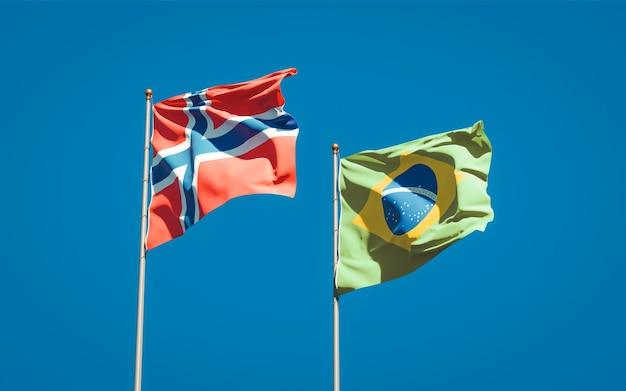 Beaux drapeaux nationaux de la norvège et du brésil ensemble sur ciel bleu