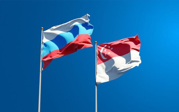 Beaux drapeaux nationaux de la nouvelle russie et de singapour ensemble