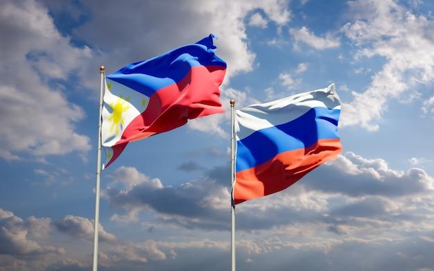Beaux drapeaux nationaux des philippines et de la russie ensemble sur le ciel bleu. illustration 3d
