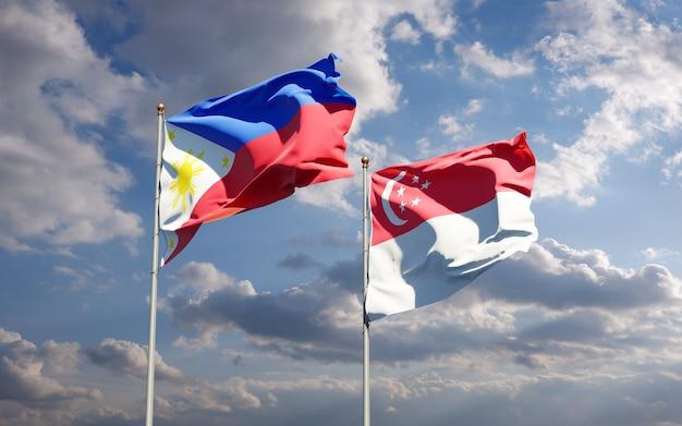 Beaux drapeaux nationaux des philippines et de singapour ensemble