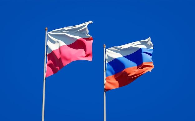 Beaux drapeaux nationaux de la pologne et de la russie ensemble sur le ciel bleu. illustration 3d