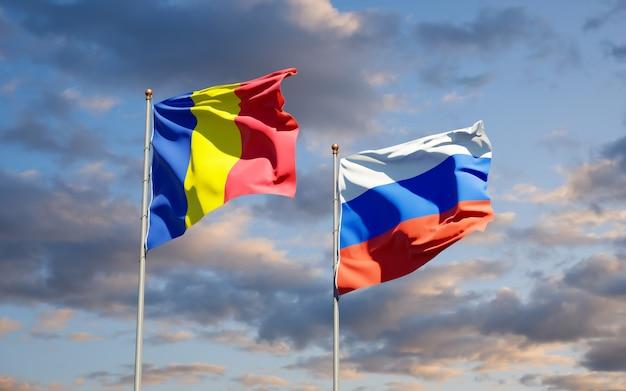 Beaux drapeaux nationaux de la roumanie et de la russie ensemble sur le ciel bleu. illustration 3d