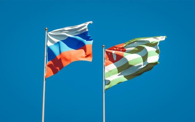 Beaux drapeaux nationaux de la russie et de l'abkhazie ensemble