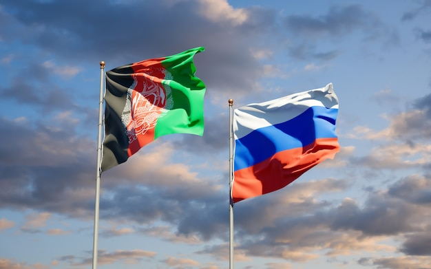 Beaux drapeaux nationaux de la russie et de l'afghanistan ensemble sur le ciel bleu. illustration 3d