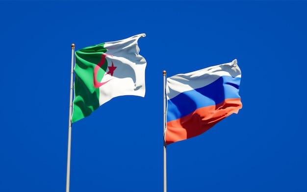 Beaux drapeaux nationaux de la russie et de l'algérie ensemble sur le ciel bleu. illustration 3d
