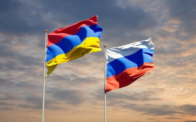 Beaux drapeaux nationaux de la russie et de l'arménie ensemble sur le ciel bleu. illustration 3d