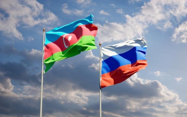 Beaux drapeaux nationaux de la russie et de l'azerbaïdjan ensemble sur le ciel bleu. illustration 3d