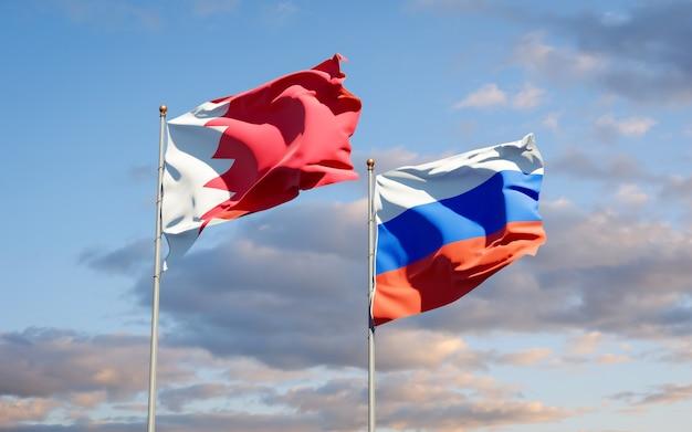 Beaux drapeaux nationaux de la russie et de bahreïn ensemble sur le ciel bleu. illustration 3d