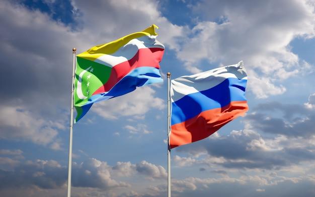Beaux drapeaux nationaux de la russie et des comores ensemble sur le ciel bleu. illustration 3d