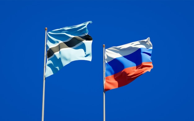 Beaux drapeaux nationaux de la russie et du botswana ensemble sur le ciel bleu. illustration 3d