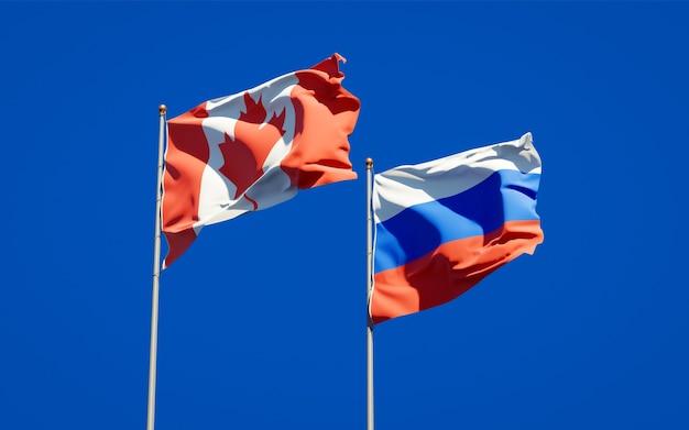 Beaux drapeaux nationaux de la russie et du canada ensemble sur le ciel bleu. illustration 3d