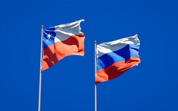 Beaux drapeaux nationaux de la russie et du chili ensemble sur le ciel bleu. illustration 3d