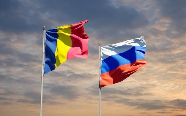 Beaux drapeaux nationaux de la russie et du tchad ensemble sur le ciel bleu. illustration 3d