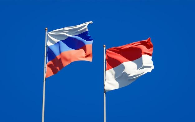 Beaux drapeaux nationaux de la russie et de l'indonésie ensemble sur ciel bleu